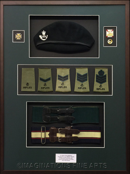 collection of army memorabilia mounted and framed
